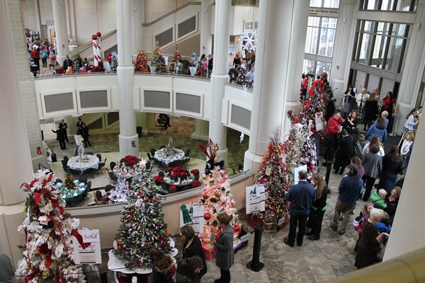 Picture of patrons viewing tree gallery at the Festival of Trees.