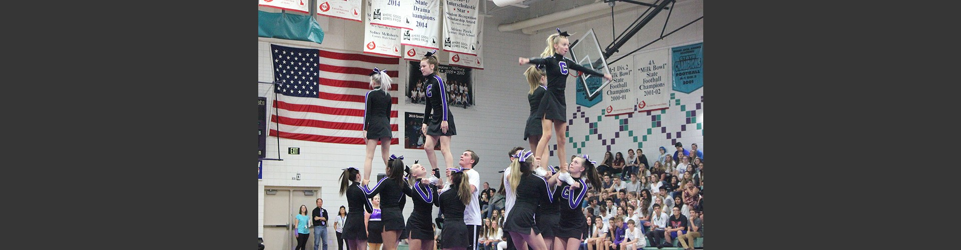 Century High School cheerleading squad performing for students.