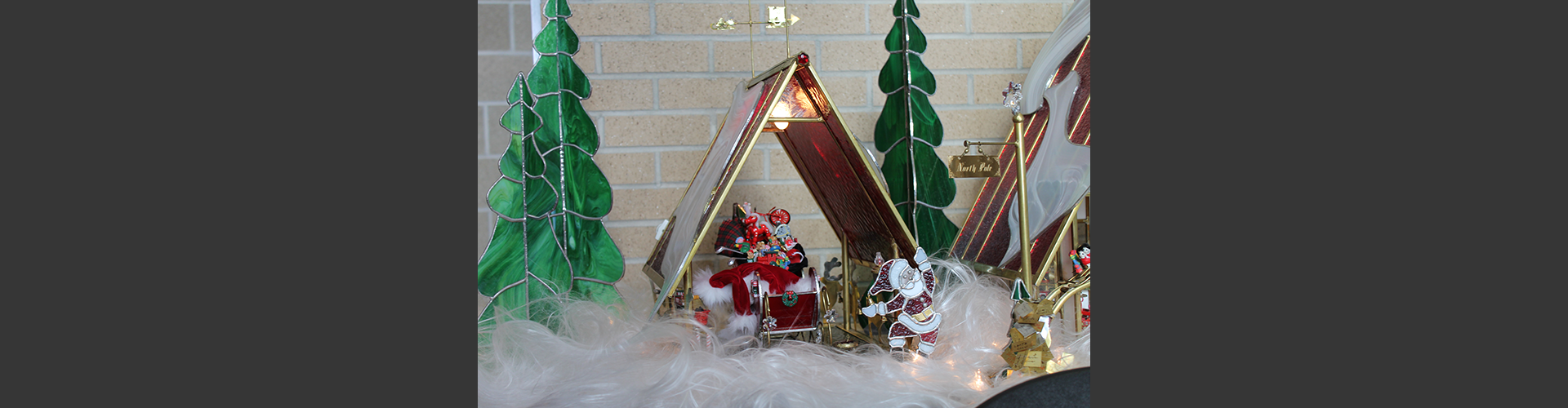 image of a glass nativity display of Santa's Workshop at the Festival of Trees